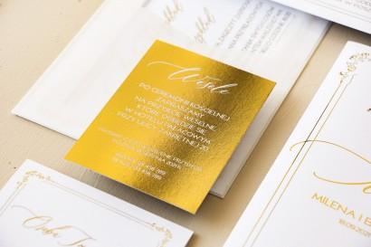 Minimalistyczne zaproszenia ślubne w białym kolorze ze złoceniami. Zaproszenia ślubne z ozdobną ramką