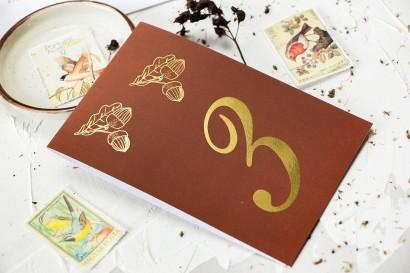 Jesienne Numery stolików weselnych ze złoceniem z motywem żołędzi