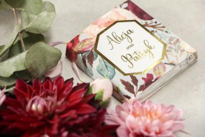 Podziękowanie dla gości weselnych w postaci mlecznej czekoladki, owijka z złoconą ramką oraz napisami - Lotus nr 5