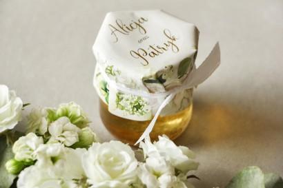 Słoiczek z miodem - słodkie podziękowanie dla gości weselnych. Kapturek ze złoconymi napisami oraz z białymi różami