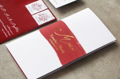 Menu ślubne z bordową akwarelową grafiką i złotymi napisami na okładce